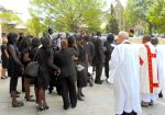 The crowd gathers after Manute's funeral.