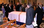 Pallbearers carry Manute's casket.